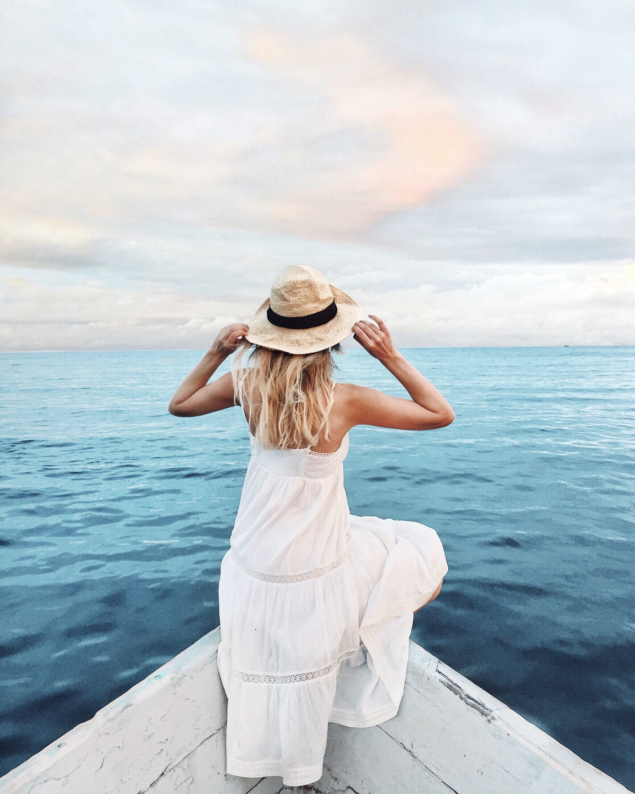 Woman wearing a hat on a boat